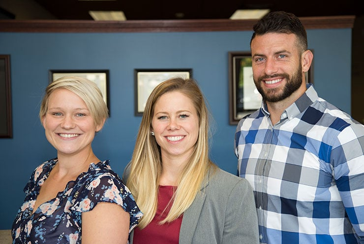 Chiropractors Crystal Lake IL Josh Young and Emily Schultz with Staff